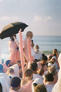 Srila Maharaja speaking on the beach at Jagannath Puri.